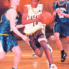 2/21/97- lasalle 1--takaaki iwabu photo -- LaSalle HS Caston Binger drives between ............... defenders during the Friday's playoff game. <br /> <br /> sports, Saturday