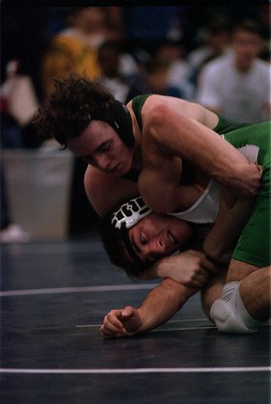 98/1/3 Nefane Wrestle2-Rachel Naber Photo-Irv Reinard of Lakeshore  (top) struggles to take down miguel Pardon of Lewport in the 140 pound weight class at newfane High School.