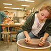 5/22/97--NFCC ART CLASSES--DAN CAPPELLAZZO PHOTO--NIAGARA WHEATFIELD SCHOOL 16-YR-OLD STACEY DuFOUR WORKS ON THE ELECTRIC WHEEL AS INSTRUCTOR OF THE TEEN COMPREHSIVE ART CALSS AT NFCC CARL SCHIFANO GUIDES OTHER STUDENTS.<br /> <br /> LOCAL SATURDAY