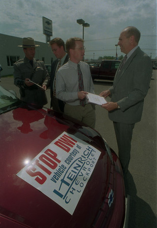 98/06/02 Traffic Safty Cars - James Neiss Photo - NYS Police Zone 1 Commander Ralph E. Pratt,David Heinrich, Charles Heinrich and Niagara county Sheriff Thomas A. Beilein. Belein and Pratt give an award to the Heinrich's for lending cars to be used in the recient county traffic safty fair at the nf air base.... See attached release.
