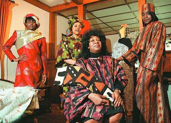 3/23/97--AFRICAN CLOTHING--DAN CAPPELLAZZO PHOTO--BRENDA HAMILTON SITS WITH HER DAUGHTER 16-YR-OLD MICHELLE HAMILTON (FAR RIGHT) , JIBRIA HOWARD, 16 AND THERESA HAYNES, 15 WHO ARE ALL WEARING THE AFRICAN/AMERICAN DESIGNS THAT MRS HAMILTON CREATED WITH FRABIC SHE HAS IMPORTED FROM NIGERIA AND OTHER AFRICAN COUNTIES.<br /> <br /> NEWS/TUESDAY 1A