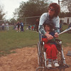 """5/30/97-- H. baseball 2 --Takaaki Iwabu photo-- Joey Moltrup gets ready for his swing with the assist of Penny Conley. Each player pair up with a """"buddy,"""" who helps them playing. <br /> <br /> Sunday 1A, bw"""