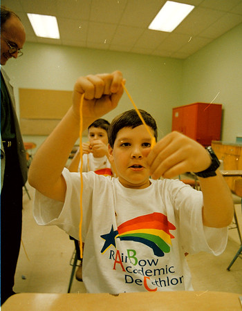 4/12/97-- rainbow academic--Brendan McDermid photo-- Joey Bradley, 11, of Maple Ave. School uses a string as he participates in Rainbow Adademic Decathlon. <br /> <br /> local, Sunday