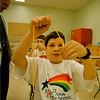 4/12/97-- rainbow academic--Brendan McDermid photo-- Joey Bradley, 11, of Maple Ave. School uses a string as he participates in Rainbow Adademic Decathlon. <br /> <br /> local, Sunday