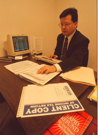 4/11/97 H&R Block - James Neiss Photo - Tax deadline is near, hear, Herman P. Capello, Supervisor of the H&R Block at the Summit Park Mall Sears works on a tax return.