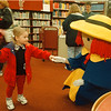 "5/3/97-- Madeline --Takaaki Iwabu photo-- Taylor Cochran, 3, Town of Niagara, meets Madeline after the ""Madeline"" stories were read at children's library in Niagara Falls Public Library Saturday. <br /> <br /> grapevine photo"