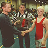 98/01/09--WRESTLER/100th WIN--DAN CAPPELLAZZO PHOTO--NF SOPHOMORE WRESTLER CHRIS COUGHENOUR IS PRESENTED WITH  A 10TH WIN AWARD BY COACH RICK SWEENEY AND REFEREE  DAN HANLEY.<br /> <br /> SP