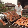 5/29/97 Chiavetta's 1--Takaaki Iwabu photo-- Chris Anzalone and Jim Cozzo of Chiavetta's Catering prepare 500 of chicken barbecue at Hyde Park Thursday.