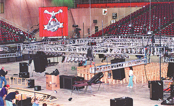 2/6/97--FIGHTING 3--DAN CAPPELLAZZO PHOTO--CREWS DISMANTLE THE RING AT THE NFCC DUE TO A STATE RULING TO CANCEL THE ULTIMATE FIGHT.<br /> <br /> 1A