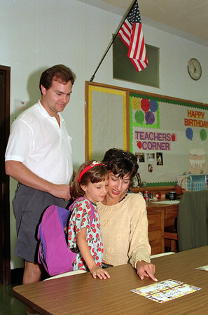98/09/02 Your New Desk *Dennis Stierer Photo -<br /> Tom Glaser looks over where his wife Kim Marie and daughter Hannah,5 will sit in her new class of Kindergarden at DeSales Catholic School. Wednesday evening was open house to meet your new teacher and find your classroom.