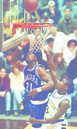 1/21/97--HOOPS--CAPPY PHOTO--NU'S CHRIS WATSON GOES UP FOR THE FIRST 1/2 LAY UP AGAINST DAVID CAPERS AT THE REILLY CENTER.<br /> <br /> SP