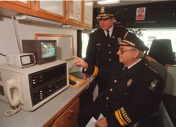 5/27/97 Cops & Cameras 2 - James Neiss Photo - Deputy Ernest Palmer and Superintendent Anthony C. Fera monitor activity on the corner of Pierce and 13th in the Mobile Command Post. The police department mounted a camera on a telephone pole to monitor drug activities at the corner.