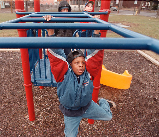 2/20/97-- g. park --Takaaki Iwabu photo-- Rasham Sylvester, 13, plays at a colorful jungle gym with his friends in Gluck Park on South Ave and 15th St. ( pic of improvements made to Prk....) <br /> <br /> local, Saturday