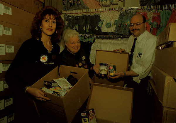 "97/12/15-- food drive --Takaaki Iwabu photo-- ""Change'n A Can"" food drive was taken place at Factory Outlet Mall. (Over 40 boxes of food were donated to Salvation Army Monday)  From left, Rita Giarrizzo; store manager of Pfaltzgraff, Pat Ward; store manager of Osh Kosh, and Steve Hill; manager at Famous Brands Youse Wares and president of Mall Merchant Association.    --grapevine photo"