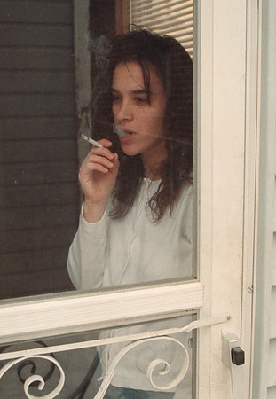 2/15/97 Smoking Space - James Neiss Photo - After having a baby, Melisa Blackmer of Spruce Ave. decided to smoke in a outside porch away from the child.