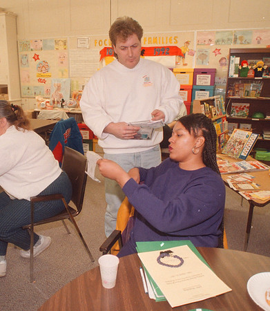 3/10/97 Parent Drug Awairness 1 - James Neiss Photo - Niagara Falls Police Detective Patrick Stack, talks to parents in an effort to help them become aware about drug abuse. Here, he shows Phillisia Williams of Michigan ave, what crack cocain and user paraphernalia.