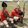 97/08/16-- old fort --Takaaki Iwabu photo-- Re-enactors dressed as The 8th (King's) Regiment Light Infantry Company take a rest at Old Fort Niagara Saturday, the first day of Soldiers of the Revolution. From left, John Stewart, Bill Johnson and Eric Bloomquist. <br /> <br /> Saturday, 3A, color