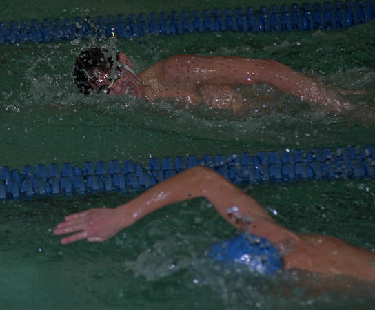 97/12/05--LKPT SWIMMING--DAN CAPPELLAZZO PHOTO--LOCKPORT'S  MARK SCRATON, FAR LANE, RACES KEN WESTS' CHRIS O'NEIL TO THE FINISH IN THE 200 FREESTYLE AT LKCPT HIGH.<br /> <br /> SP