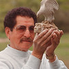 "5/29/97 Joseph Jacobs 2 - James Neiss Photo - Tuscarora Native American Sculptor - Joseph Jacobs, a Master Native American Artist, shows off ""Guardian of the Mountain"" which he carved."
