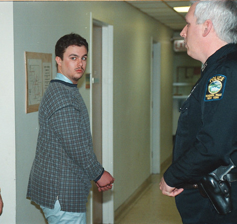 1/31/97 Ronald J. Triscari - James Neiss photo - Triscari is arraigned  in Niagara Falls City Court for the brutal murder of his elderly neighbor with a knife.