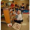 97/08/97 Holy Ghost School - James Neiss Photo - Carol Kromphardt, Pre-School Instructor, Jonathan Lynch 7yrs/2nd, and Daniel Lynch 10yrs/5th, help Wilber Kromphardt, Former Principal of the school, fill the shelves he just built for his wife's class at the Holy Ghost Lutheran School.