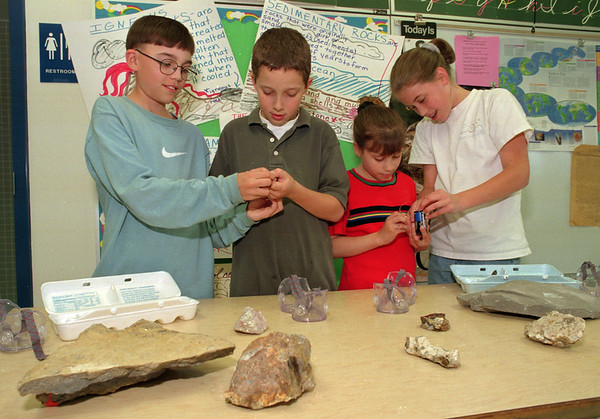 98/05/07 Science Project *Dennis Stierer Photo - Students Brett Finnan, Billy Kumpf, Felicia Benedict, and Molly Brewer, all 5th graders in Cristina Finnerty science class at Charles Upson Elementary School were working on a project to determine which rocks and minerals would conduct electricity. This is still a wonderful science project as Ms. Finnerty did this same project twenty years ago as a student at Washington Hunt.