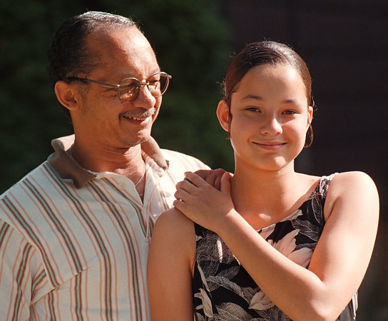 97/09/21--FAHTER/DAUGHTER REUNION--DAN CAPPELLAZZO PHOTO--17-YR-OLD ISABELLE SCHRAMM GETS A SUPPORTIVE HAND FROM HER FATHER WILLIAM HARRISON AT THEIR GRAND AVE HOME. THE TWO WERE REUINTED RECENTLY.<br /> <br /> 1A TOPIC