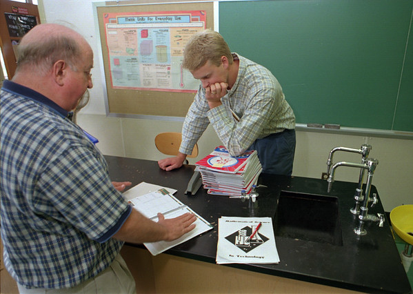 98/09/03  Mentor Teach-Rachel Naber Photo-Dick Hiwiller (left)  a teacher will be mentoring Thomas Forrestel a new teacher in 8th grade Science at Medina Middle School to help him over the rough spots and share in the sucess of students this fall.
