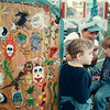 7/10/97 fun fest--Takaaki Iwabu photo-- Brandon O'Connor, 3, gets a face paint from Barbara Henderson while his brother Justin waits for his turn at Barbie's Face Painting in Fun Festival Thursday. The annual festival at Niagara Catholic HS will continue through weekend. <br /> <br /> 1A, Friday, color / 3A, Friday, bw