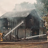 97/08/04 Village Fire - James Neiss Photo - Lewiston #1 Volunteer Firefighters fought a garage/barn fire at 445 Cayuga in the village of Lewiston.