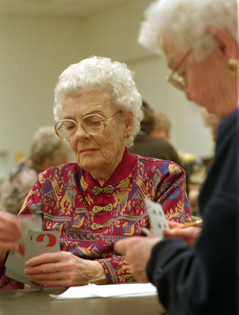 98/02/18 Bid Pitch *Dennis Stierer photo - Playing bid pitch is serious fun as Ida House gets ready to make her play. Sitting to the right in the photo is Mary Strassburg. The photo was taken at the Senior center as a stand alone feature.