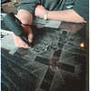 5/15/97 Niagara Monument 3 - James Neiss Photo - Robert Harmon, Lead Artist at Niagara Monument Works Ink, Reflects in his work as heTouches up a etching of a cross with a rose on French Creek Granite.