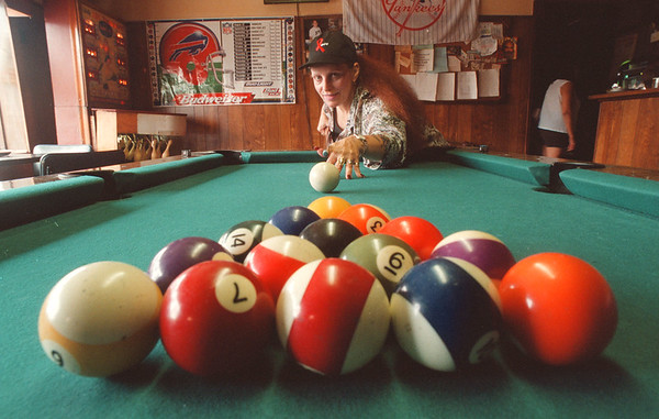 8/1/97 Habitat Pool Tournament - James Neiss Photo - Barbara Walker, Co-Chair of Habitat for Humanity Pool Tourney. She prepairs to break at Easy Pete's on Pine Ave.