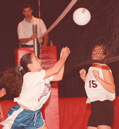 97/09/19--VOLLYBALL--DAN CAPPELLAZZO PHOTO--N.C.'S ADELL HOOVER PUNCHES THE BALL TOWARDS THE NET AS SACRED HEART FORWARD MARY LEAPER WAITS FOR THE RETURN VOLLY AT NC HIGH.<br /> <br /> SP