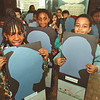 1/30/97--black history --Takaaki Iwabu photo--Students at Harry F. Abate School hold the posters that feature their dreams and silhouettes celebrating Black History Month. Standing front are, from left, Dominique Smith, Anthony Lamar and Keenan Palmer.