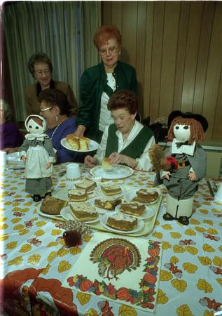97/11/19 Thanksgiving Dinner - James Neiss Photo - The Annual Sanborn Nite Seniors Thanksgiving Dinner - Gertrude Becken, director, serves rolls to Margaret Schulz, tresurer at the annuyal dinner.