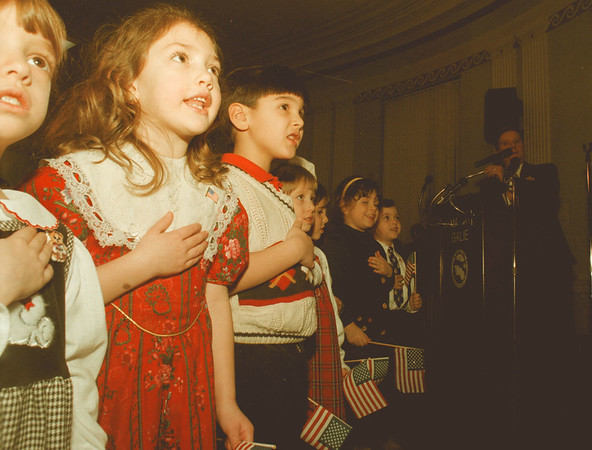98/01/28--City Adress ---Students of Our Lady Mt. Carmel School says pledge to the flag as Mayor Jim Galie, right,  looks on, Wednesday night at City Hall. Mayor made the state of the City address after this ceremony. <br /> <br /> Grapevine photo