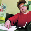 3/13/97-- social service-- Takaaki Iwabu photo-- Karen Pearson, social walfare examininer, assists her cliant at Niagara County Building Thursday. (Cliant is trying to prevent utility companies shutting off the service to her place..... /for Topic on social service reform)<br /> <br /> 1A Friday