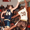 98/02/06--HOOPS/LASALLE/LKPT--DAN CAPPELLAZZO PHOTO--LKPTS CHARLIE CROFF GOES TO THE BOARDS AGAINST JAMES DAVIS IN SECOND HALF ACTION.<br /> <br /> SP