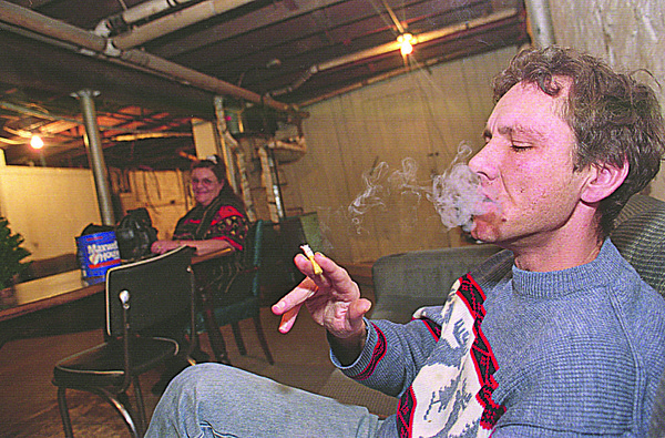 1/5/96--MENTAL HOME 3--CAPPY PHOTO--SEE JUDY FOR ID (JIM???) HAS A CIGGY AS KELLY LOOKS ON. RESIDENTS ARE GIVEN CONTROLLED CIGARETTE BREAKS DURING THE DAY.