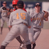 98/05/15-- HS baseball --Takaaki Iwabu photo-- Niagara Falls High School's Jeff Haynes gets caught between bases after he was picked off by LaSalle's pitcher. LaSalle's second baseman (#4) is William Day. <br /> <br /> bw, sports, Saturday