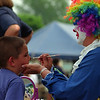 6/12/97--60TH STREET SCH.FUN DAY-DAN CAPPELLAZZO PHOTO--6-YR-OLD 60TH STREET SCHOOL KINDERGARDENER MICHAEL FOUTS  GETS A DOG FACE PUT ON COMPLETE WITH  NOSE AND WISKERS BY PARENT/VOLUNTEER CLOWN FACE PAINTER DEBBIE WILLIAMS AT THE 60TH STREET  SCHOOL FUN DAY THURSDAY AFTERNOON.<br /> <br /> GRAPEVINE