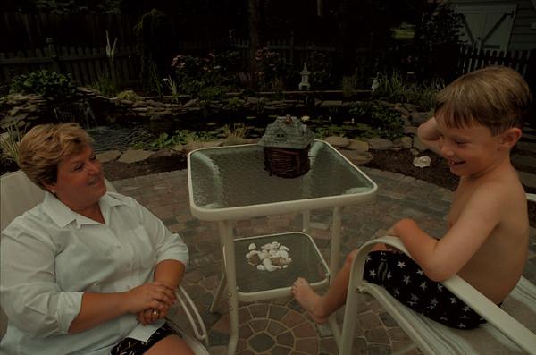 98/08/05--Garden 4--Takaaki Iwabu photo-- Marty Garner of Lewiston talks to her friendÕs grandson, Patrick Rowland, in front of her garden...