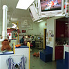 98/11/06 Friendly Enviroment *Dennis Stierer Photo -<br /> Dr. Louis A. Surace, a pediatric dentist in Lockport works on the tooth of a patient with the help of Kimberly Johnson, Dental Assistant in the surroundings of a very child friendly atmosphere, complete with TV's at each station showing children's movies.