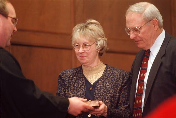 99/1/03 Seaman2-rachel naber Photo-Judge John Batt(left) sworn in assemblyman David Seaman (right) with help of his wife Bonnie Seaman (middle).