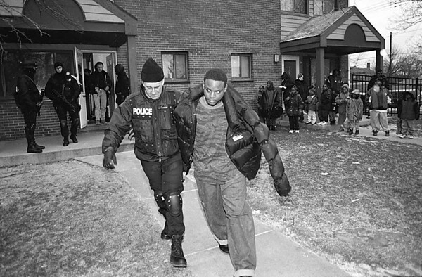 1/23/97--CRACK RAID--CAPPY PHOTO CAPT. OF THE STREET CRIME UNIT AND MEMBER OF THE QUICK ENTRY TEAM NF POLICE CAPT. WILLIAM WENDT LEADS A SUSPECT OUT OF THE JORDAN GARDENS AFTER A RAID TURNED UP AN ONCE OF SUSPECTED CRACK COCAINE.<br /> <br /> LOCAL