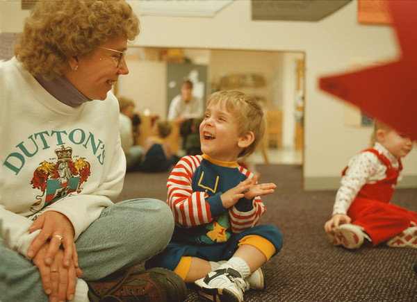 98/02/05-- classroom --Takaaki Iwabu photo-- Brandon Sponaugle, 2, shares a laughter with a teacher's aid Jane Dutton, left, during the nursery school class at Niagara Children ETC (Education and Treatment Center) Thursday. <br /> <br /> grapevine photo