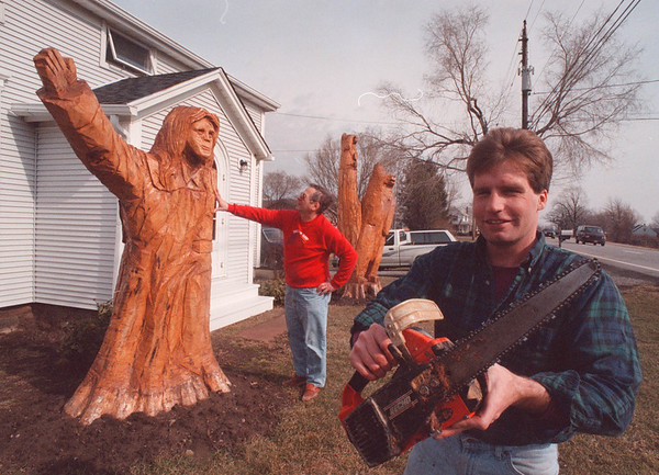2/21/97 Chain Saw Art - James Neiss Photo - L-R - Home owner George Werba of Ridge Road, Ransomville admires the handy work of Chain Saw Artist Rick Pratt.
