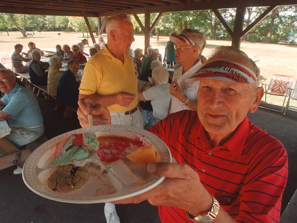 97/08/12 Lewiston Seniors - James Neiss Photo - Jennings Waldron of Ridge Rd, Lewiston and other members of the Lewistion Senior Center, picnic at Joseph Davis State Park. Here he shows off some of the desserts...