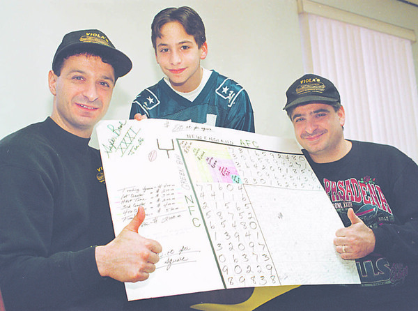 1/23/97 -- gambling SB-- takaaki iwabu photo-- Andy  Ranaletti, 12, middle, holds up the Super Bowl Pool with his uncles Pete and Tom Tardibuono at Viola's Sub Shop on Military Rd.  Customers at this family-owned Sup Shop participate in the betting in biggest football game of year.